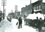 Winter snow removal scene, looking north on Fifth Street, Red Jacket, Michigan
